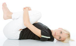 Yoga exercise. Beautiful young blondy doing yoga exercise royalty free stock photography