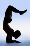 Yoga exercise. Photo of young man doing an yoga exercise stock images