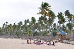 Yoga exercise in the beach Royalty Free Stock Photos