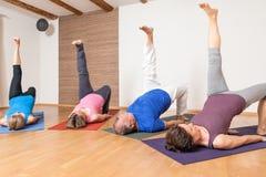 Yoga Exercise - Eka Pada Setu Bandha Sarvangasana Stock Photo