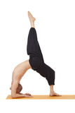 Yoga exercise. Instructor posing in difficult pose Stock Photography