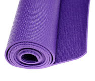 Yoga exercise mat. Looking down at a rolled up yoga or pilates exercise mat isolated on white Stock Image