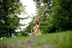Position for good feeling. Yoga exercise in nature park stock photography