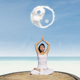 Yoga exercise under Yin Yang cloud Stock Images