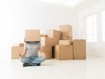 Yoga exercise before unpacking Royalty Free Stock Images