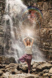 Yoga exercise on the waterfall background Stock Photography