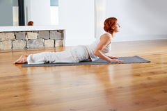 Yoga exercise in wooden floor gym and mirror Royalty Free Stock Images