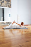 Yoga exercise in wooden floor gym and mirror Stock Photo