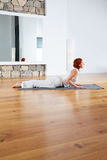 Yoga exercise in wooden floor gym and mirror Stock Photography