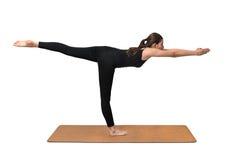 Yoga exercise, young woman pose on yoga mat Royalty Free Stock Photo