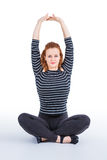 Yoga exercise. Young woman practicing yoga exercise Royalty Free Stock Images
