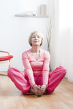 Yoga Exercises. Mature Woman doing yoga exercises Royalty Free Stock Photo
