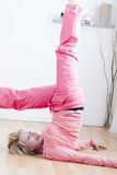 Yoga Exercises. Mature Woman doing yoga exercises Royalty Free Stock Photography