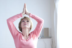 Yoga Exercises. Mature Woman doing yoga exercises Stock Photos