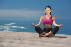 Yoga Exercises. Beautiful young woman in outdoor doing yoga Stock Photography