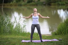Yoga exercises outdoors. / A young girl / Portrait Royalty Free Stock Images