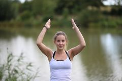 Yoga exercises outdoors. / A young girl / Portrait Royalty Free Stock Photography