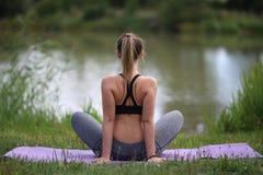 Yoga exercises outdoors. / A young girl / Portrait Stock Photos