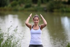 Yoga exercises outdoors. / A young girl / Portrait Royalty Free Stock Image