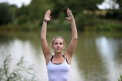 Yoga exercises outdoors. / A young girl / Portrait Stock Images