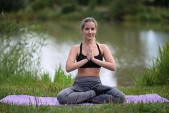 Yoga exercises outdoors. / A young girl / Portrait Stock Photography