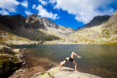 Yoga exercising in Tatry mountains Stock Image
