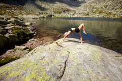 Yoga exercising in Tatry mountains Royalty Free Stock Images