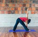 Yoga extended triangle pose Royalty Free Stock Photography