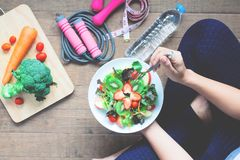 Yoga female cooking homemade salad Royalty Free Stock Photography