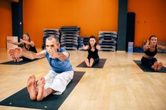 Yoga, female group with instructor in motion royalty free stock photo