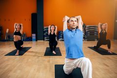 Yoga, female group with instructor in motion Royalty Free Stock Images
