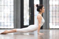 Yoga in fitness center: Urdhva mukha shvanasana Stock Photo