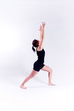 Yoga fitness woman. A woman in a yoga pose on a plain white backdrop Stock Photography