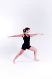 Yoga fitness woman. A woman in a yoga pose on a plain white backdrop Stock Images
