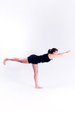 Yoga fitness woman. A woman in a yoga pose on a plain white backdrop Royalty Free Stock Image