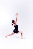 Yoga fitness woman. A woman in a yoga pose on a plain white backdrop Royalty Free Stock Photography