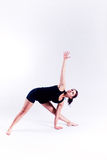 Yoga fitness woman. A woman in a yoga pose on a plain white backdrop Royalty Free Stock Photos