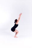 Yoga fitness woman. A woman in a yoga pose on a plain white backdrop Stock Photo