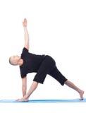 Yoga. Flexible man practising in studio Royalty Free Stock Image