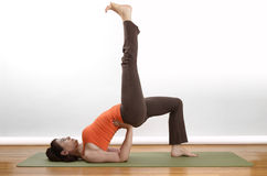 Yoga floor position. Women holds an extended bridge yoga pose Stock Photos