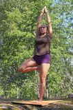 Yoga in forest Stock Photo