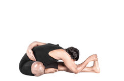 Yoga forward bending pose Stock Images