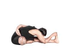 Yoga forward bending pose Stock Images