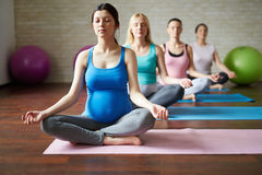 Yoga for future mothers stock photos