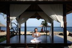 Yoga in a Gazebo. Woman meditating inside a gazebo stock photography