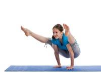 Yoga - giovane bella donna che fa excerise Fotografia Stock