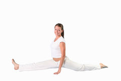 Yoga girl. The sports girl in a pose yoga on a  white  background Stock Photo