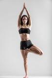 Yoga girl in asana Vriksasana, Tree Pose Royalty Free Stock Image