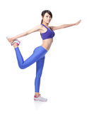 Yoga girl in blue gym suit Royalty Free Stock Image