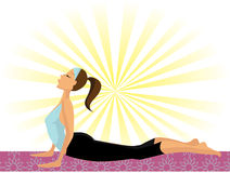 Yoga Girl (doing the Cobra Pose or Bhujangasana) Stock Photo